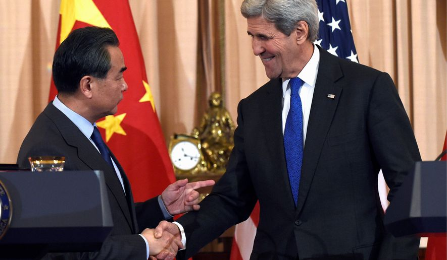 China took an unusually combative tone ahead of the meeting between Chinese Foreign Minister Wang Yi and Secretary of State John F. Kerry on Tuesday, with the Chinese Foreign Ministry asserting that Beijing's actions in the South China Sea were no different from Washington's positioning of military assets on Hawaii. (Associated Press)