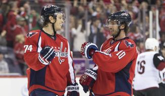 Washington Capitals defenseman John Carlson (74) and teammate Mike Richards (10) congratulate each other as time expires in a 3-2 victory over the Arizona Coyotes, on Monday, Feb. 22, 2016, in Washington. (AP Photo/Evan Vucci)
