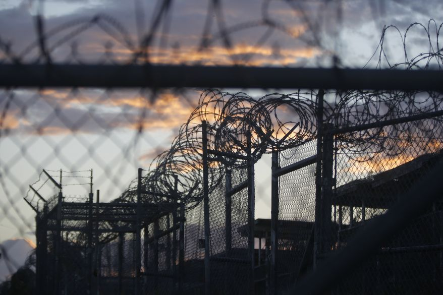 In this Nov. 21, 2013, file photo reviewed by the U.S. military, dawn arrives at the now closed Camp X-Ray at the Guantanamo Bay Naval Base in Cuba — a camp that was used as the first detention facility for al Qaeda and Taliban militants who were captured after the Sept. 11, 2001, attacks on the U.S. (AP Photo/Charles Dharapak, File)