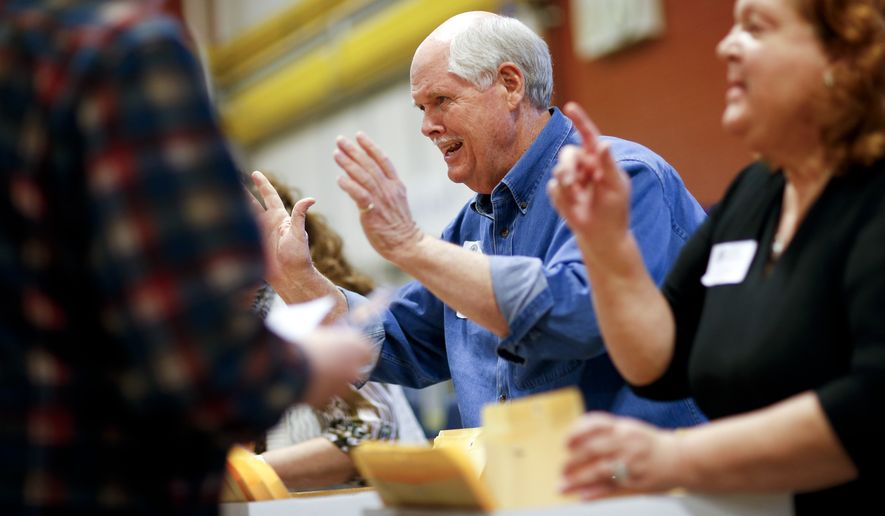 Caucus workers give instructions at a Republican caucus site Tuesday in Las Vegas. (Associated Press)