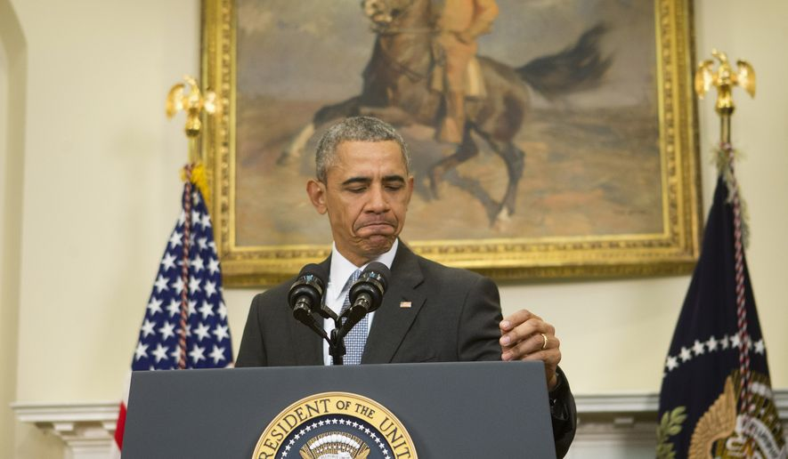 President Obama walks up to the podium before speaking in the Roosevelt Room of the White House in Washington on Feb. 23, 2016. Obama announced the Pentagon's long-awaited plan to shut down the detention center at Guantanamo Bay, Cuba, and transfer the remaining detainees to a facility in the U.S. The plan is Obama's last-ditch effort to make good on campaign vow to close Guantanamo. (Associated Press)