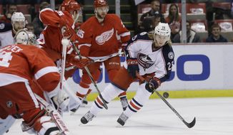 Columbus Blue Jackets center William Karlsson (25) shoots the puck toward Detroit Red Wings goalie Petr Mrazek (34) during the first period of an NHL hockey game, Tuesday, Feb. 23, 2016, in Detroit. (AP Photo/Carlos Osorio)