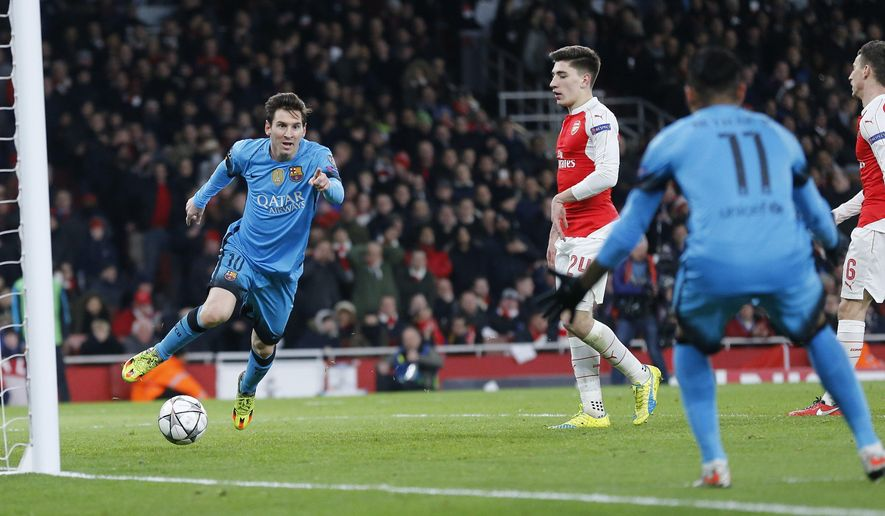 Barcelona's Lionel Messi, left, celebrates after scoring the opening goal during the soccer Champions League round of 16 first leg soccer match between Arsenal and Barcelona at the Emirates stadium in London, Tuesday, Feb. 23, 2016. (AP Photo/Frank Augstein)