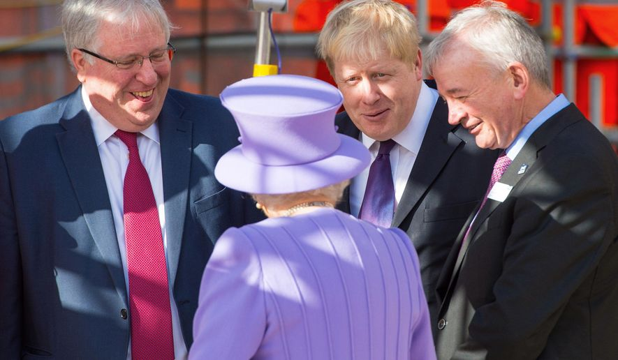 Britian's Queen Elizabeth II, centre, talks to Transport Secretary Patrick McLoughlin, left, and Mayor of London Boris Johnson, centre, during a royal visit to the construction site of the new Bond Street Crossrail Station in central London, Tuesday Feb. 23, 2016.  The Queen is scheduled to tour the Crossrail project which will provide new links through new tunnels under Central London, opening in 2018, (Dominic Lipinski / PA via AP) UNITED KINGDOM OUT - NO SALES - NO ARCHIVES
