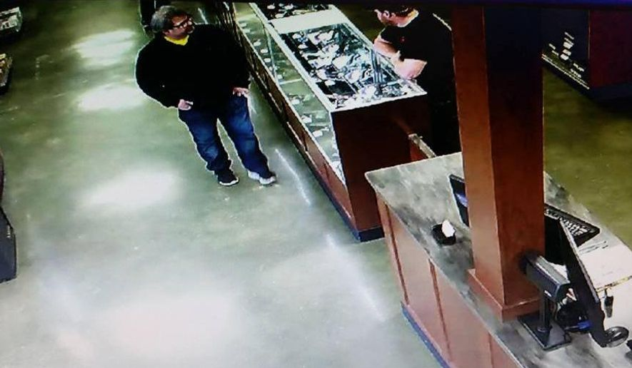 In this Saturday, Feb. 20, 2016 photo provided by Southwick's gun store, Jason Dalton, left, appears in the store in Plainwell, Mich., hours before he went on a shooting rampage. Dalton admitted to gunning down randomly chosen victims in and around Kalamazoo, Mich., — attacks apparently carried out over hours during which he also ferried passengers around town as an Uber driver. (Southwick's Gun Store via AP)