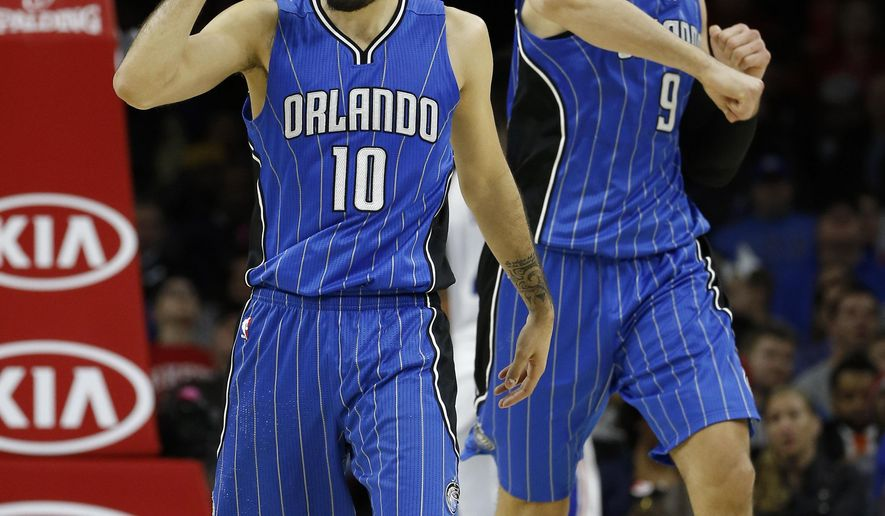Orlando Magic's Evan Fournier, left, and Nikola Vucevic celebrate after a basket during the second half of the team's NBA basketball game against the Philadelphia 76ers, Tuesday, Feb. 23, 2016, in Philadelphia. Orlando won 124-115. (AP Photo/Matt Slocum)
