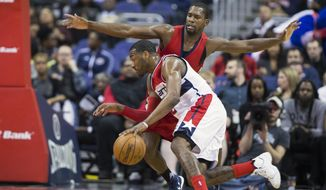 New Orleans Pelicans guard Toney Douglas, right, defends Washington Wizards guard John Wall during the first half of an NBA basketball game, on Tuesday, Feb. 23, 2016, in Washington. (AP Photo/Evan Vucci)