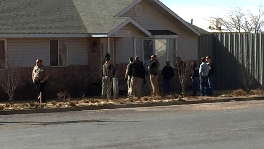 This photo provided by Andrew Chatwin shows law enforcement officers conducting a search at the Wedgewood Development construction company in Hildale, Utah on Tuesday, Feb. 23, 2016. Police are searching businesses in the polygamous town on the Utah-Arizona border. The U.S. Attorney's Office in Utah said in statement Tuesday that federal, state and local authorities are carrying out actions approved by a court. Officials didn't elaborate, saying court documents are sealed. (Andrew Chatwin via AP)