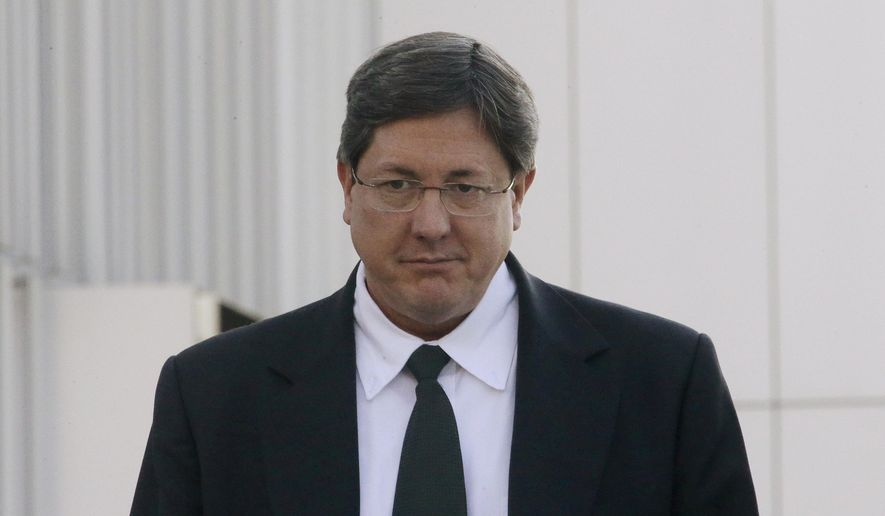 FILE - In this Jan. 21, 2015 file photo, Lyle Jeffs leaves the federal courthouse in Salt Lake City. On Tuesday, Feb. 23, 2016, several top leaders from Warren Jeffs' polygamous sect, including Lyle Jeffs, were arrested on federal accusations of food stamp fraud and money laundering — marking one of the biggest blows to the group in years. (AP Photo/Rick Bowmer, File)