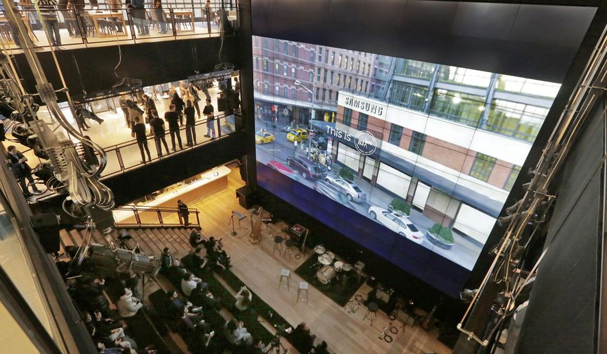 """The exterior of Samsung's flagship store, Samsung 837, is shown on a video wall during a media preview of the facility, in New York's Meatpacking District, Monday, Feb 22, 2016. Samsung is opening what it calls a """"technology playground"""" in New York for customers to check out its latest gadgets. The center opens Tuesday, the day Samsung starts taking orders for its upcoming Galaxy S7 and S7 Edge phones. (AP Photo/Richard Drew)"""