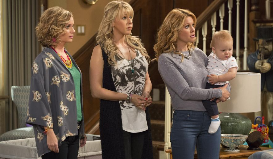 "This image released by Netflix shows, from left, Andrea Barber, Jodie Sweetin, and Candace Cameron Bure in a scene from, ""Fuller House,"" streaming on Netflix beginning on Friday, Feb. 26. (Michael Yarish/Netflix via AP)"