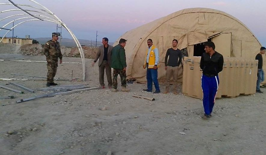 """A field hospital set up by American volunteers in Northern Iraq on Feb. 9 opened just in time to take in 12 Kurdish peshmerga hit by Islamic State mortar shells carrying chemical munitions. They are part of the Qalubna Makum, Arabic for """"Our hearts are with you."""""""
