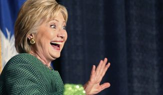 Democratic presidential candidate Hillary Clinton waves as she arrives to speak at an Alpha Kappa Alpha Sorority luncheon in West Columbia, S.C., Wednesday, Feb. 24, 2016. (AP Photo/Gerald Herbert)