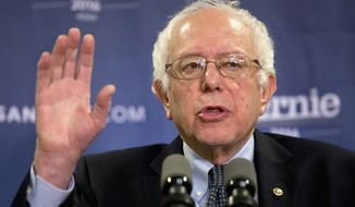 Sen. Bernard Sanders, who is losing black voters to Hillary Clinton by a 3-1 margin, impugned her record championing minorities by linking her to welfare reforms that preceded a dramatic rise in poverty rates over the past two decades. (Associated Press)