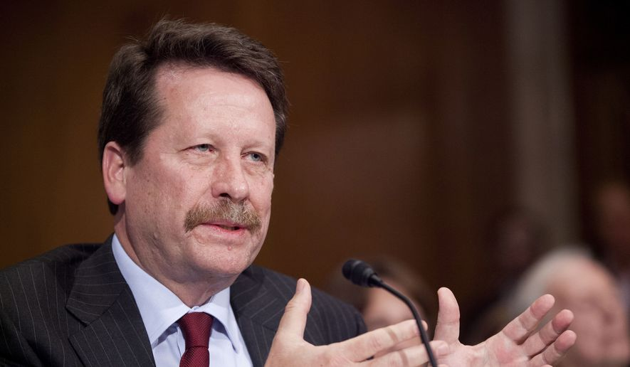 In this Nov. 17, 2015, file photo, Dr. Robert Califf, President Obama's nominee to lead the Food and Drug Administration (FDA), testifies on Capitol Hill in Washington. The Senate has confirmed Califf to be commissioner of the FDA. (AP Photo/Pablo Martinez Monsivais, File)