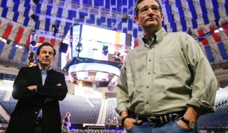 Sen. Ted Cruz, R-Texas, left, accompanied by his communications director, Rick Tyler, right, arrives for a walk-through for his Monday morning speech where he will launch his campaign for president of the United States at Liberty University on Sunday, March 22, 2015 in Lynchburg, Va. Cruz will be the first major candidate in the 2016 race for president. (AP Photo/Andrew Harnik)