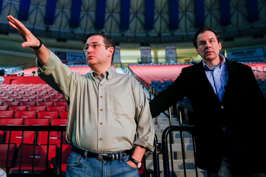 Sen. Ted Cruz (left), Texas Republican, accompanied by his communications director, Rick Tyler, arrives March 22, 2015, for a walk-through for a speech the next morning in which he will launch his campaign for president of the United States at Liberty University in Lynchburg, Va. Cruz will be the first major candidate in the 2016 race for president. (Associated Press) **FILE**