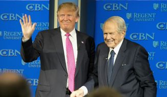 Republican presidential candidate, Donald Trump, accompanied by Rev. Pat Robertson, waves as he arrives for an appearance at Regent University in Virginia Beach, Va., Wednesday, Feb. 24, 2016.  (AP Photo/Steve Helber)