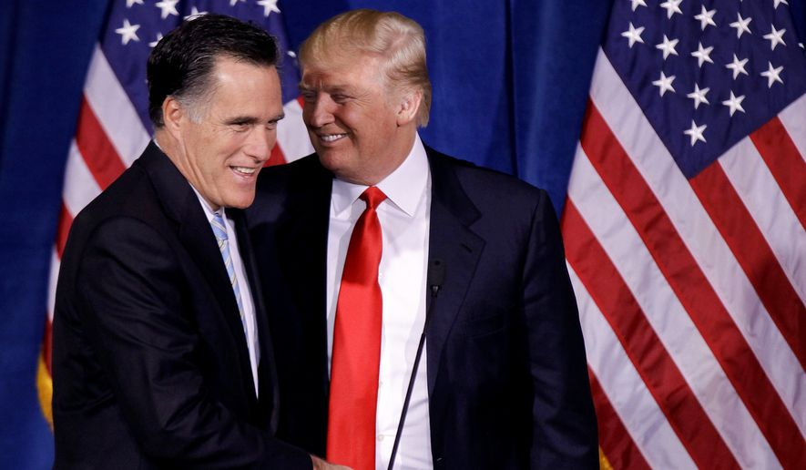 Donald Trump greets Mitt Romney on Feb. 2, 2012, after announcing his endorsement of the former Massachusetts governor during a news conference in Las Vegas. (Associated Press)