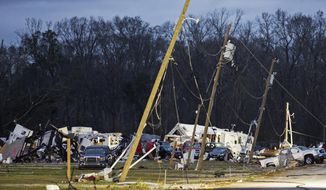 Wreckage of the Sugar Hill RV Park is scattered in Convent, La., Wednesday, Feb. 24, 2016. Tornadoes and severe weather ripped through the Gulf Coast on Tuesday, mangling trailers at an RV park, ripping off roofs from buildings in Louisiana and Mississippi, authorities said. (AP Photo/Max Becherer)