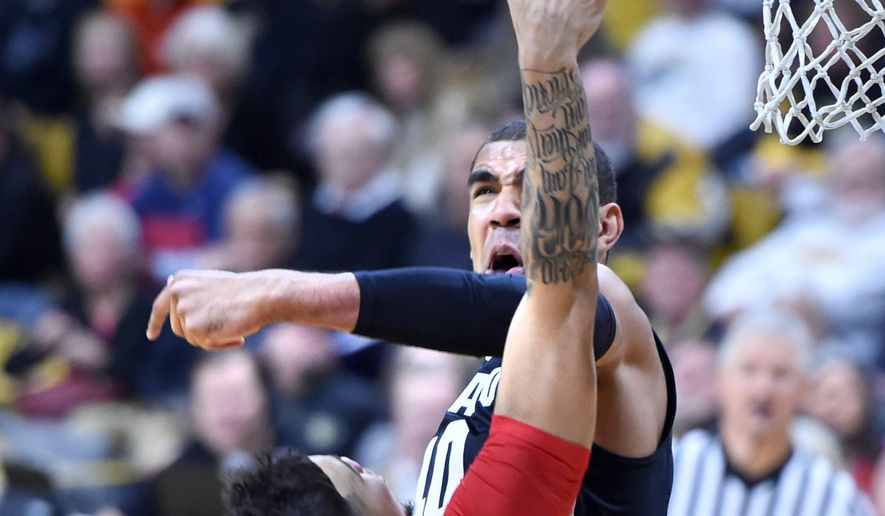 Colorado forward Josh Scott blocks the shot of Arizona's Gabe York during the first half of an NCAA college basketball game Wednesday, Feb. 24, 2016, in Boulder, Colo. (AP Photo/Cliff Grassmick)