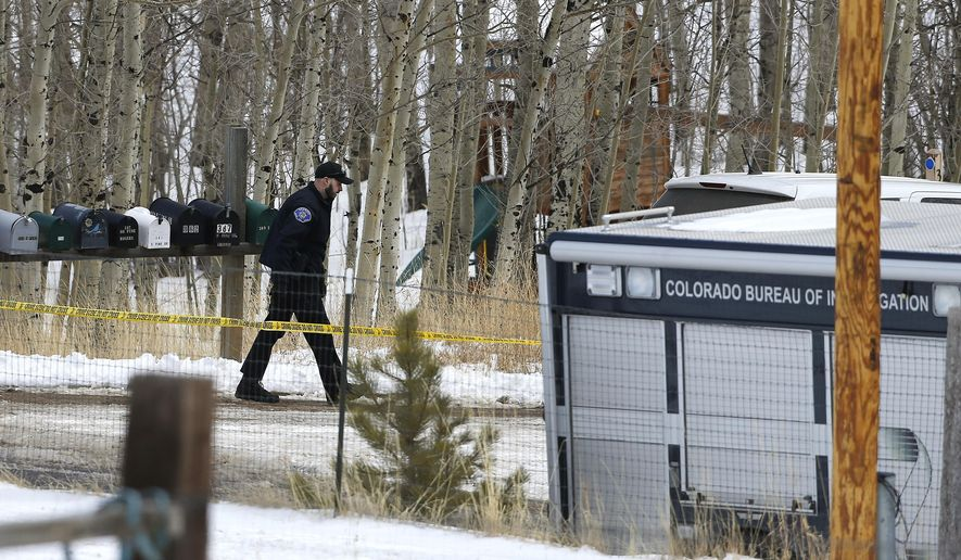 A law enforcement officer works at the scene where a man opened fire on several sheriff's deputies before the officers returned fire, killing the man, outside Bailey, Colo., Wednesday, Feb. 24, 2016. Authorities say the man, who lost ownership of his home two years ago, opened fire on the officers trying to serve an eviction notice. (AP Photo/Brennan Linsley)