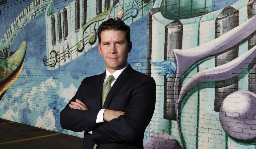 In this photo taken on Friday, Sept. 4, 2015, Brendon Anthony poses in Deep Ellum in Dallas. Anthony  is the new director of the Texas Music Office and formerly the fiddle player in country star Pat Green's band. The office deals with promoting Texas music and Brendon is seeking to tie its mission more to economic development. (David Woo /The Dallas Morning News via AP) MANDATORY CREDIT; MAGS OUT; TV OUT; INTERNET USE BY AP MEMBERS ONLY; NO SALES