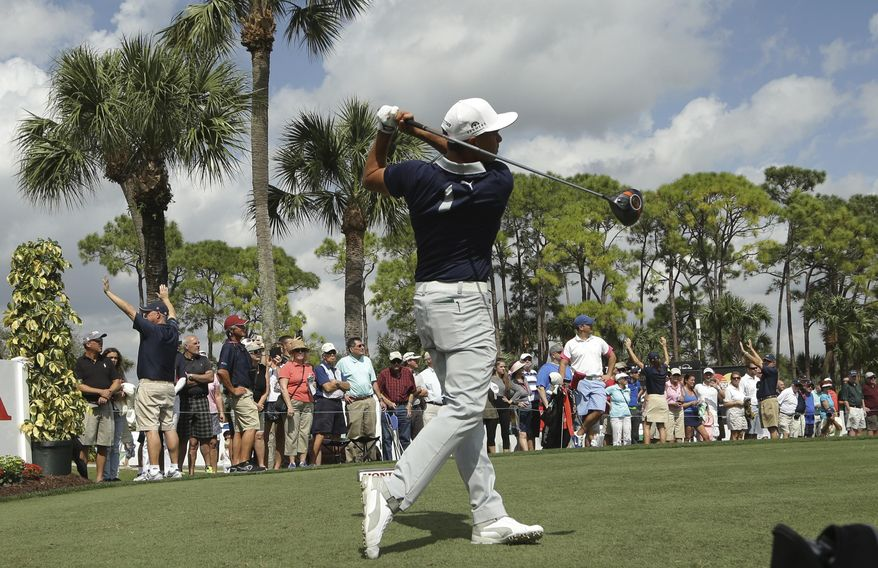 Rickie Fowler tees off on the 18th hole during the pro-am at the Honda Classic golf tournament, Wednesday, Feb. 24, 2016, in Palm Beach Gardens, Fla. (AP Photo/Lynne Sladky)