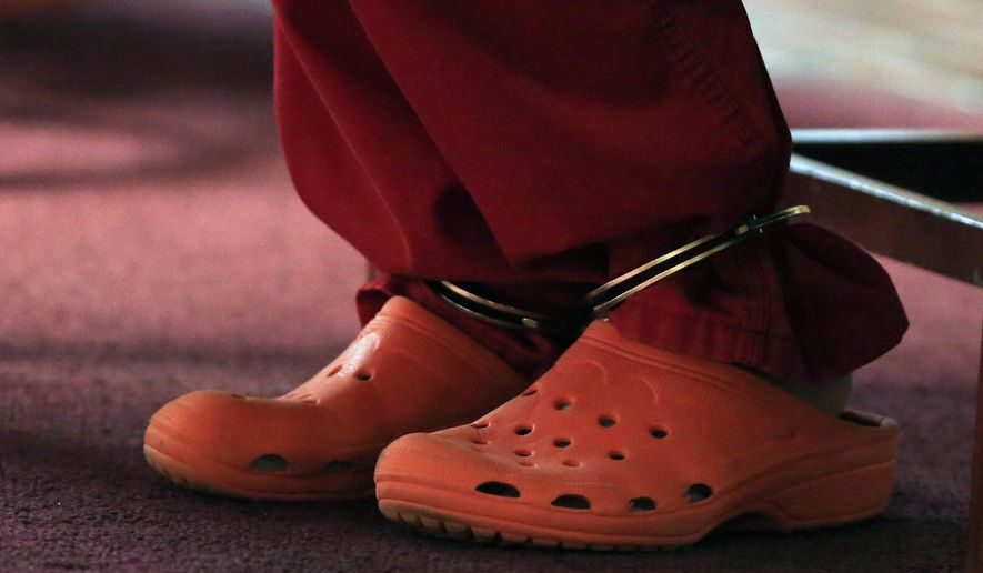 Tara Lambert appears in court in Circleville, Ohio, on Wednesday, Feb. 24, 2016,  in red jail scrubs and rubber shoes after a judge earlier denied her motion to allow her to appear in street clothes and makeup. Lambert, convicted of trying to hire a hit man to kill her husband's ex-wife, has been sentenced to seven years in prison.  (Kyle Robertson/The Columbus Dispatch via AP) MANDATORY CREDIT