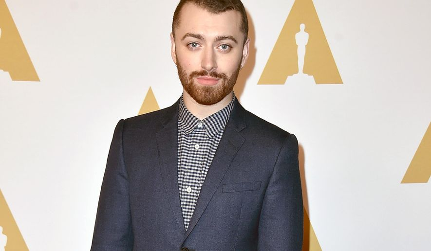 """FILE - In this Feb. 8, 2016 file photo, singer Sam Smith arrives at the 88th Academy Awards Nominees Luncheon in Beverly Hills, Calif. Smith and co-writer Jimmy Napes are nominated for best original song for """"Writing's on the Wall,"""" from the film, """"Spectre"""" at the 88th Academy Awards on Sunday, Feb. 28. (Photo by Jordan Strauss/Invision/AP, File)"""