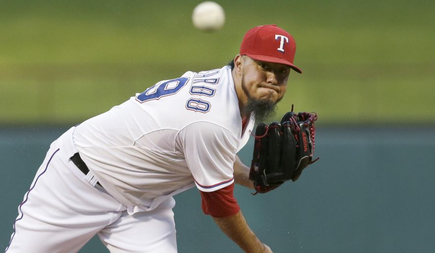 FILE - In this Friday, Sept. 18, 2015 file photo,Texas Rangers starting pitcher Yovani Gallardo throws during the first inning of a baseball game against the Seattle Mariners in Arlington, Texas. The Baltimore Orioles were hopeful Yovani Gallardo would be getting acclimated to the team by now. But the status of the team's new right-hander pitcher was still unclear as the Orioles await the results of additional medical tests they ordered, Wednesday, Feb. 24, 2016. (AP Photo/LM Otero, File)