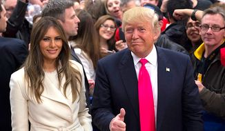 Republican presidential front-runner Donald Trump and his wife Melania, at a campaign stop in Council Bluffs, Iowa.  (AP Photo/Jae C. Hong) ** FILE **