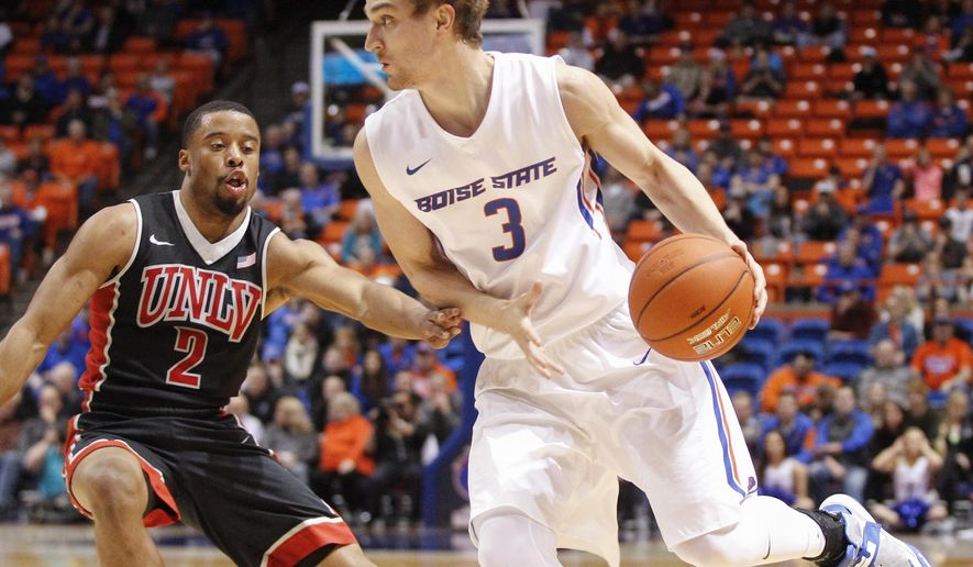 Boise State's Anthony Drmic (3) moves the ball around UNLV's Jerome Seagears (2) during the first half of an NCAA college basketball game in Boise, Idaho, on Tuesday, Feb. 23, 2016. Boise State won 81-69. (AP Photo/Otto Kitsinger)