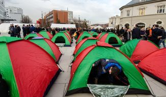 The opposition set up tents in front of the government building in Pristina, Kosovo, to continue protests to bring down the government. The protests decry EU-brokered deals with Serbia and Montenegro, which they say breach Kosovo's constitution. (Valerie Plesch/The Washington Times)