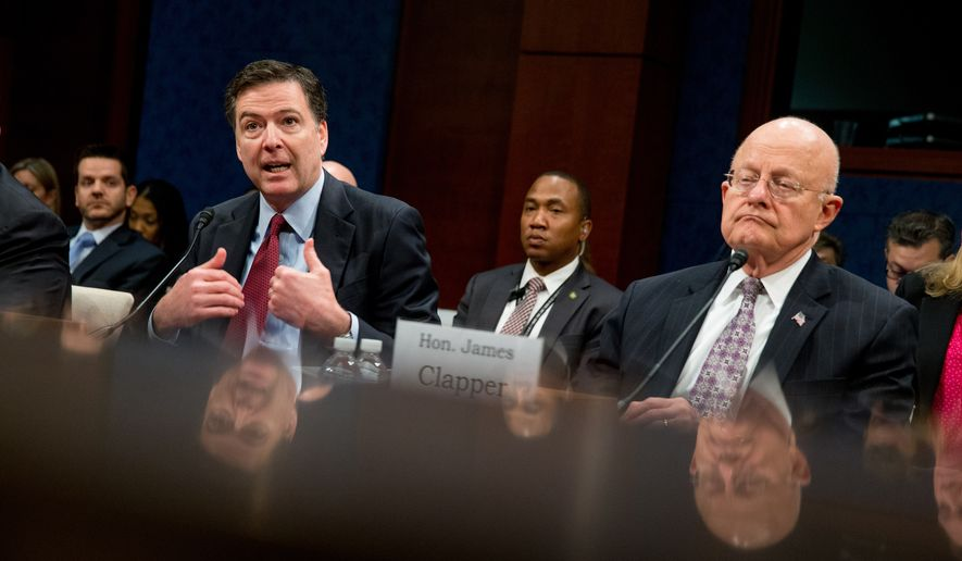 Then-FBI Director James Comey, left, accompanied by then-Director of National Intelligence James Clapper, right, speaks at a House Intelligence Committee hearing on worldwide threats on Capitol Hill in Washington, Thursday, Feb. 25, 2016. (AP Photo/Andrew Harnik) ** FILE **