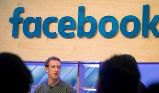 Facebook CEO Mark Zuckerberg speaks during a visit to a Facebook Innovation Hub in Berlin on Feb. 25, 2016. Zuckerberg presented studies on Artificial Intelligence. (Kay Nietfeld/dpa via AP) **FILE**