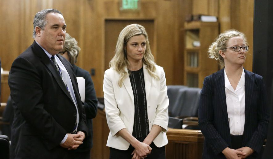 Sportscaster and television host Erin Andrews, center, stands with attorney Scott Carr, left, as the jury leaves the courtroom Thursday, Feb. 25, 2016, in Nashville, Tenn. Andrews has filed a $75 million lawsuit against the franchise owner and manager of a luxury hotel and a man who admitted to making secret nude recordings of her in 2008. (AP Photo/Mark Humphrey, Pool)