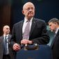 Director of National Intelligence James Clapper, center, and National Counterterrorism Center Director Nicholas Rasmussen, right, arrive at a House Intelligence Committee hearing on world wide threats on Capitol Hill in Washington, Thursday, Feb. 25, 2016. (AP Photo/Andrew Harnik)
