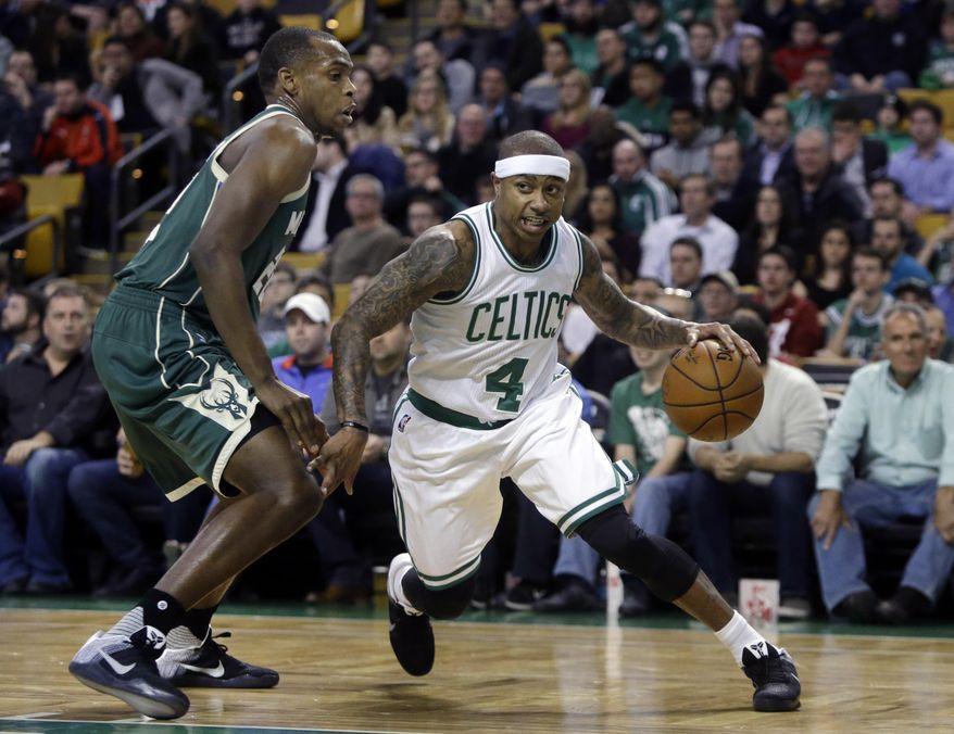 Boston Celtics guard Isaiah Thomas (4) drives against Milwaukee Bucks guard Khris Middleton (22) in the first quarter of an NBA basketball game, Thursday, Feb. 25, 2016, in Boston. (AP Photo/Elise Amendola)