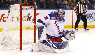 New York Rangers goalie Henrik Lundqvist, of Sweden, makes a save on a shot during the first period of an NHL hockey game against the St. Louis Blues, Thursday, Feb. 25, 2016, in St. Louis. (AP Photo/Billy Hurst)