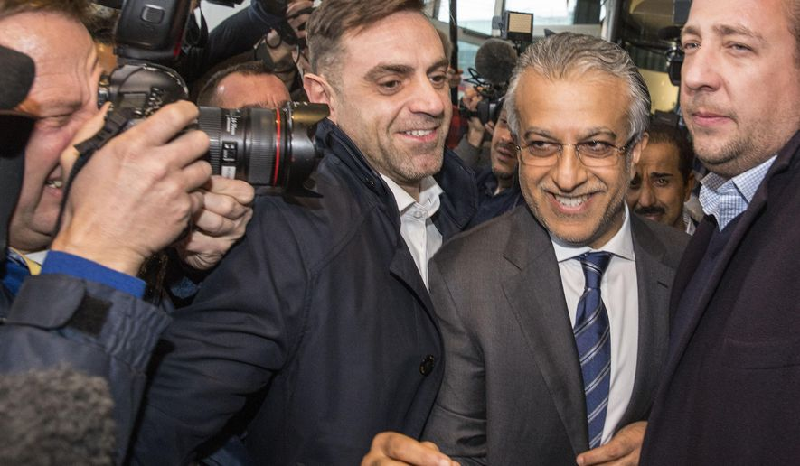 FIFA presidential front-runner Sheikh Salman Al Khalifa of Bahrain is surrounded by media in Zurich, Switzerland, Thursday, Feb. 25, 2016. The Sepp Blatter era at FIFA is set to finally end Friday, Feb. 26, 2016 when soccer's scandal-scarred world body picks a new president after nine months of crisis.  (Patrick B. Kraemer/Keystone via AP)