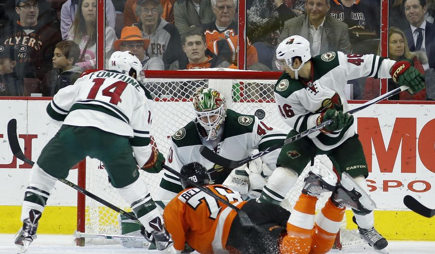 Philadelphia Flyers' Pierre-Edouard Bellemare (78) scores a goal past Minnesota Wild's Devan Dubnyk (40) as Justin Fontaine (14) and Jared Spurgeon (46) defend during the third period of an NHL hockey game, Thursday, Feb. 25, 2016, in Philadelphia. Philadelphia won 3-2. (AP Photo/Matt Slocum)
