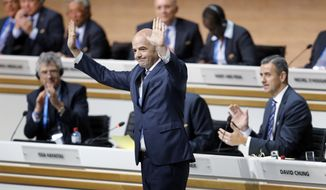 Newly elected FIFA president Gianni Infantino of Switzerland reacts during the extraordinary FIFA congress in Zurich, Germany, Friday, Feb. 26, 2016. (AP Photo/Michael Probst)