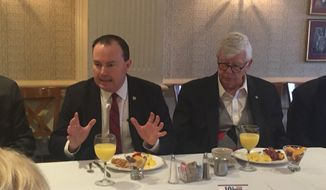 Sen. Mike Lee, Utah Republican, (left) makes a point at a Feb. 25, 2016, breakfast gathering for members of The Washington Times' Insights Club. David Keene, The Times' editorial and opinion editor and president of Insights Club, moderated. (Photo by The Washington Times)