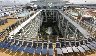 This Nov. 20, 2009, file photo, shows the cruise ship Oasis of the Seas docked at Port Everglades in Fort Lauderdale, Fla. (AP Photo/Hans Deryk, File) **FILE**