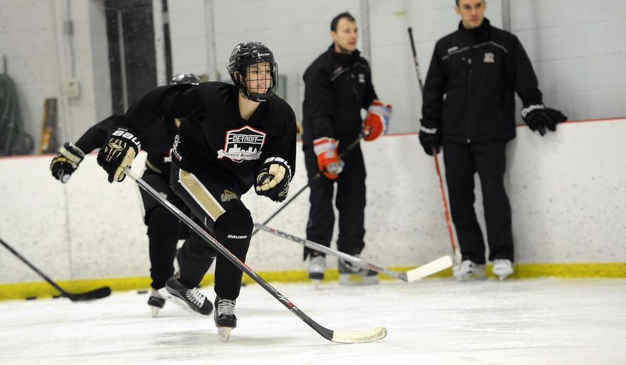 FOR RELEASE MONDAY, FEBRUARY 29, 2016, AT 12:01 A.M. EST.- Lexi Treppa of Macomb Township skates up ice during a drill at Detroit Hockey Academy Tuesday, Feb. 16, 2016, in Wixom, Mich. Treppa is not a student at the school but is considering enrollment.  (Jose Juarez/Detroit News via AP)