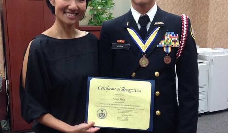 This May 2014 photo provided by Pennsylvania State Rep. Patty Kim shows Kim presenting a certificate to a man who identified as Harrisburg High School student Asher Potts. The school honors student just months from graduation was actually a 23-year-old Ukrainian national using a false identity after his visa expired, police said Thursday, Feb. 25, 2016. Artur Samarin, who used the alias Asher Potts, was arrested and charged Tuesday in Harrisburg, Pa., police said.  (Pennsylvania State Rep. Patty Kim via AP)