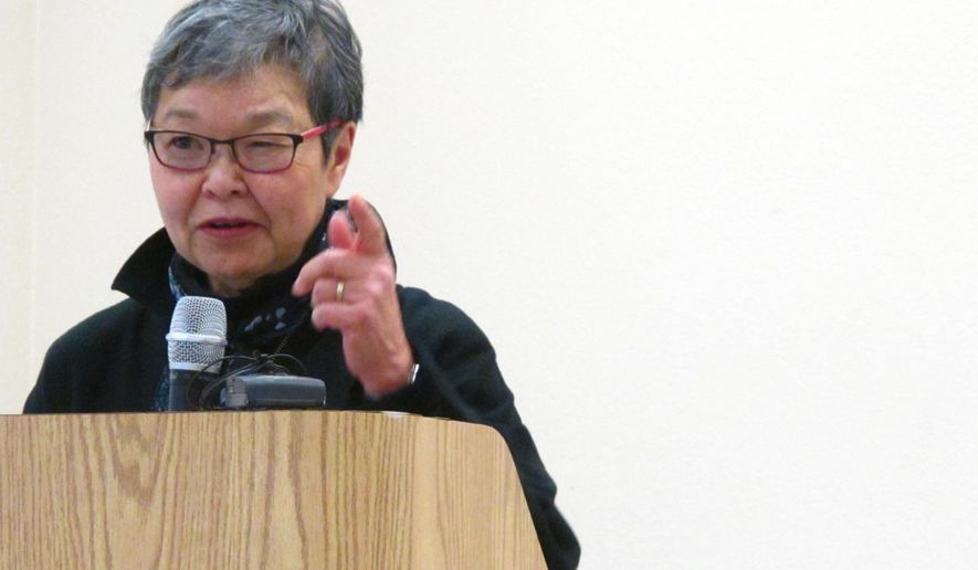 In this Friday, Feb. 19, 2016 photo at Joint Base Elmendorf-Richardson, Alaska, Mary Tanaka Abo recalls her family's incarceration in Japanese internment camps during World War II. Abo, 75, was speaking at a ceremony on base held to remember the forced incarceration of more than 200 Alaskans, as well unveil the results of a study about a little-known Japanese internment camp that was erected there during World War II. (AP Photo/Rachel D'Oro)