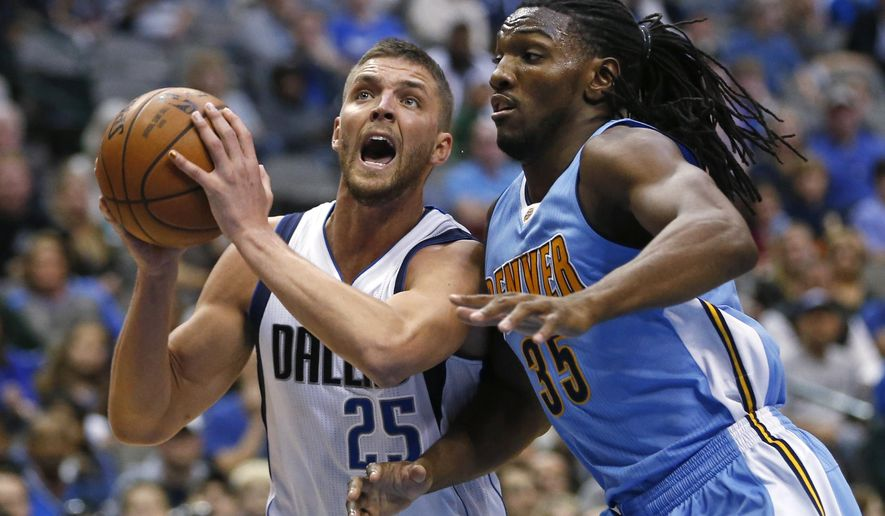 Dallas Mavericks forward Chandler Parsons (25) drives inside next to Denver Nuggets forward Kenneth Faried (35) during the second half of an NBA basketball game Friday, Feb. 26, 2016, in Dallas. (AP Photo/Ron Jenkins)