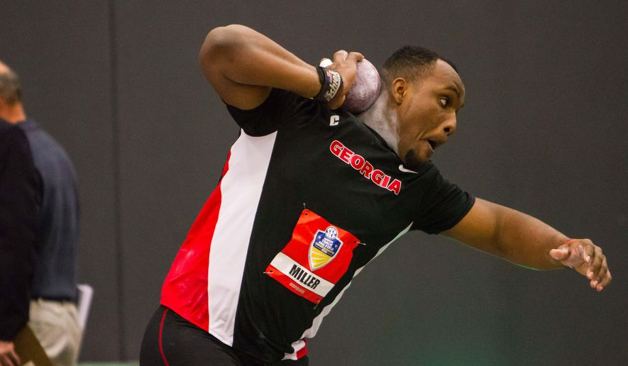 Georgia's Ashinia Miller prepares to throw the shot put during the Southeastern Conference indoor track and field championships Friday, Feb. 26, 2016, in Fayetteville, Ark. (AP Photo/Gunnar Rathbun)